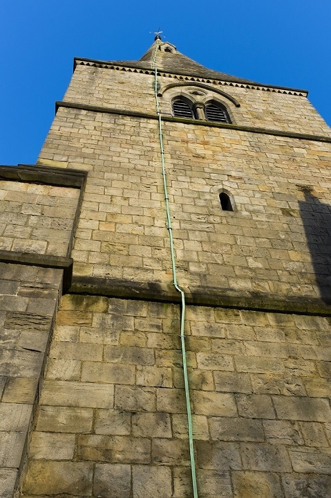 Aluminium wire from lightning rod on the side of a church in the UK.