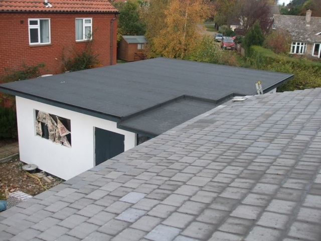 completed felt flat roof on outbuilding