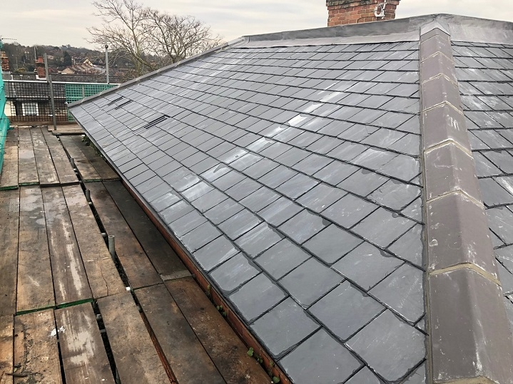 One side of the new slate roof we installed.