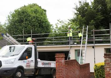Contractors installing roof system