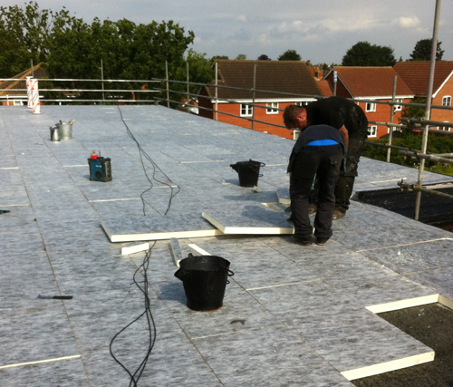 Can i make my flat roofing system more energy efficient for Energy efficient roofing