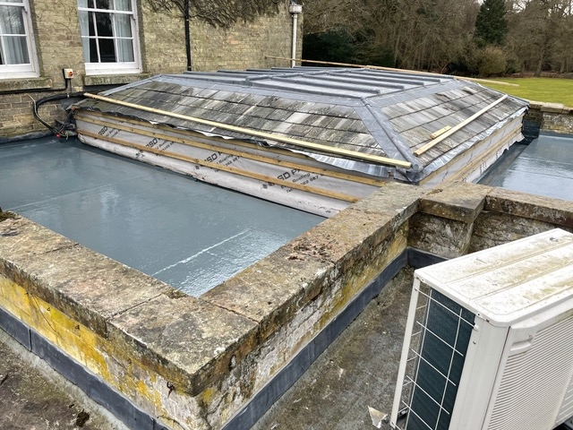 air conditioning unit on flat roof