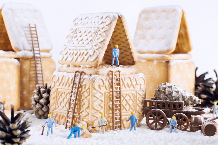 roofers fix a gingerbread house